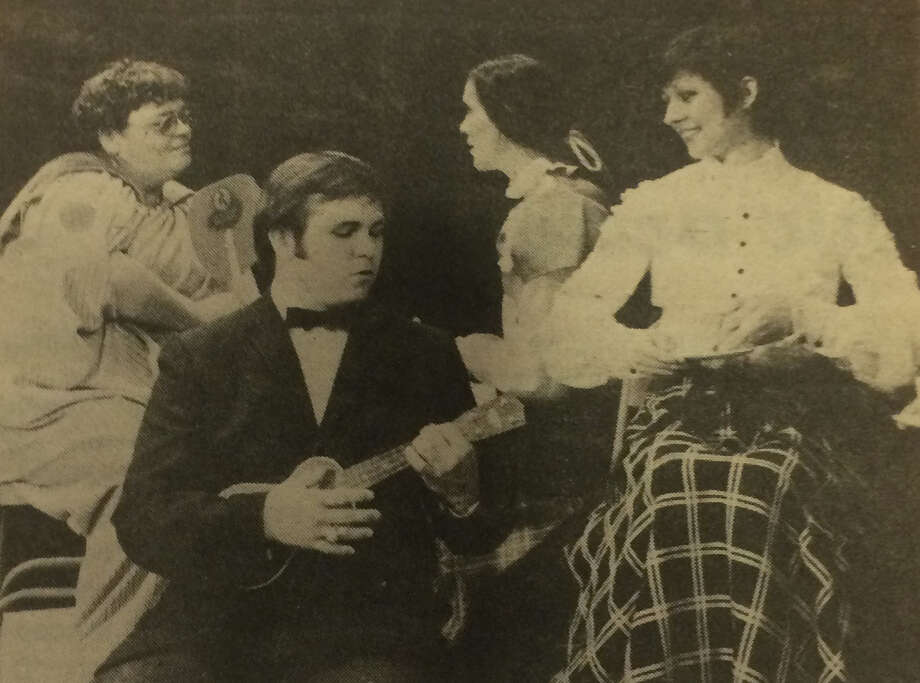 "Tom Leroy entertains at the Dixieland Boarding House in this scene from ""Look Homeward, Angel"" which was put on by the Players in the early 1980s at the Crighton Theatre. Also pictured are Julie Emmons, Susan Viser, Jan Harris and Betty Mitchell."
