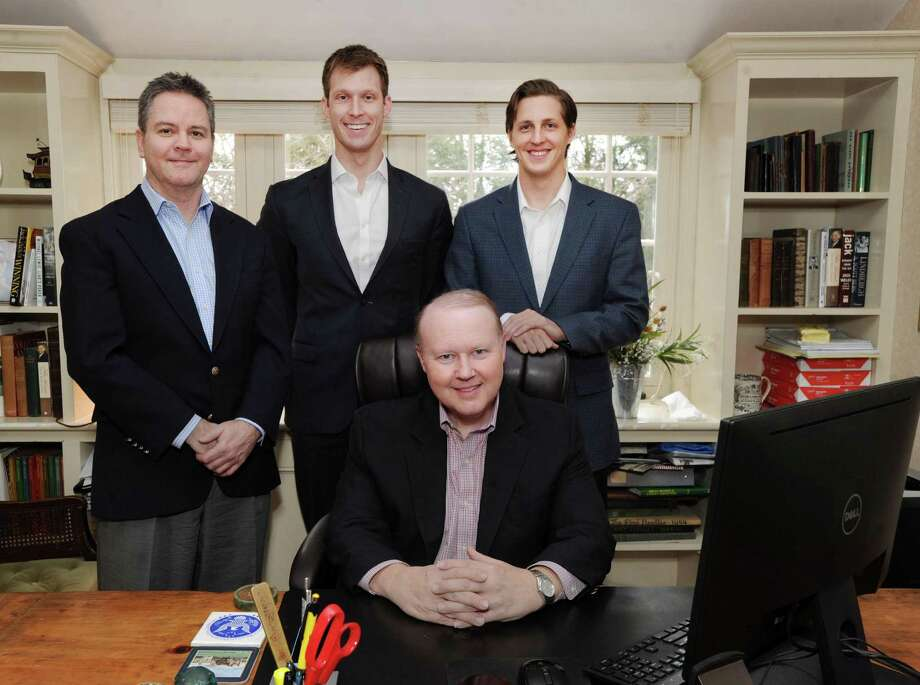 The Hunt Scanlon Media executive team from left standing, Scott Scanlon, Michael Wasulko, Chase Barbe and Christopher Hunt (seated) at the firm's headquarters in Greenwich, Conn., Friday, Jan. 27, 2017. Hunt Scanlon Media, founded in 1988 by Christopher Hunt and Scott Scanlon, is a trade publisher and market research firm covering the global executive search and human capital industries. Photo: Bob Luckey Jr. / Hearst Connecticut Media / Greenwich Time