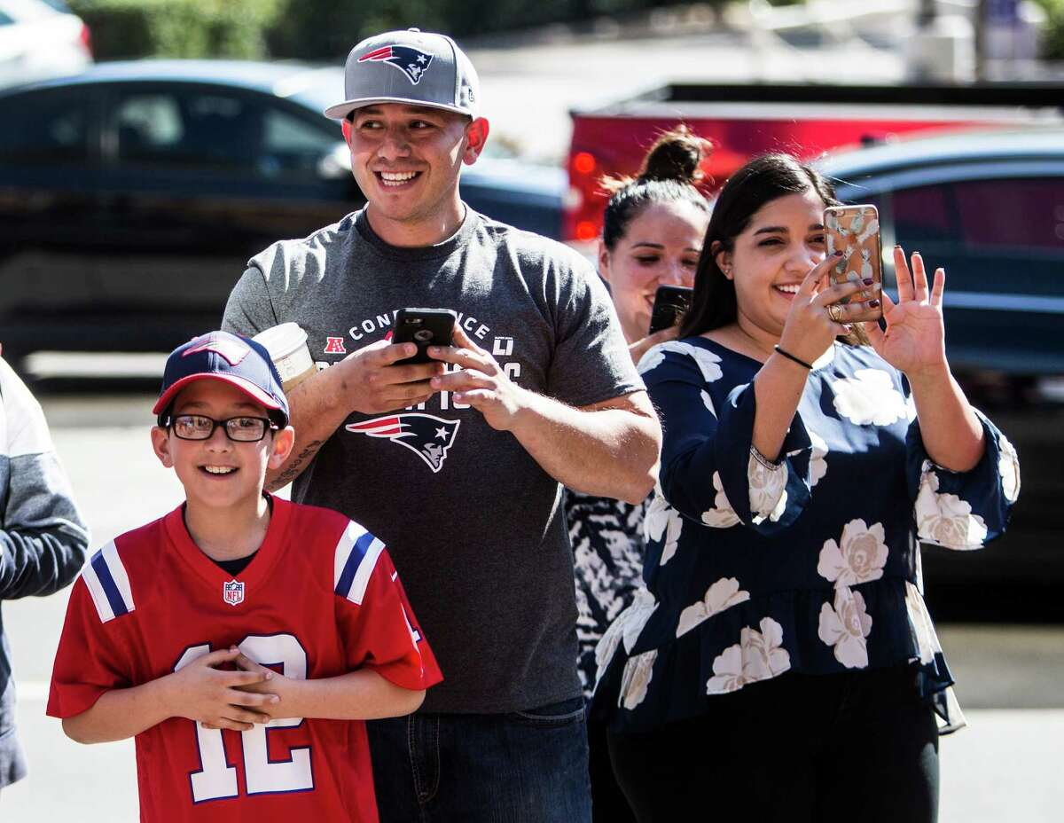 New England Patriots fans cheer as they see Patriots wide receiver Julian Edelman walk past during a news conference in advance of Super Bowl LI at the J.W. Marriott on Tuesday, Jan. 31, 2017, in Houston.
