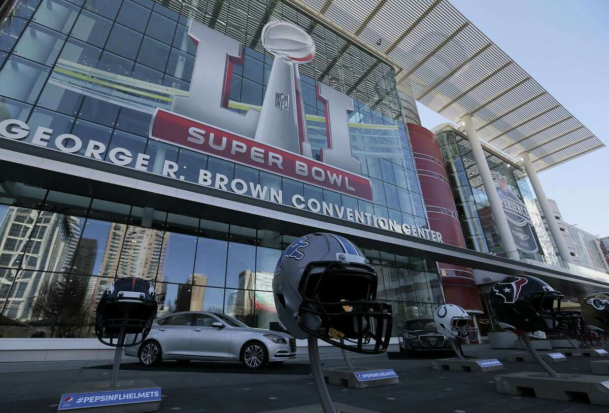 NFL helmets line the Avenida in front of the George R. Brown Convention Center in celebration of Super Bowl LI on Tuesday, Jan. 31, 2017, in Houston.