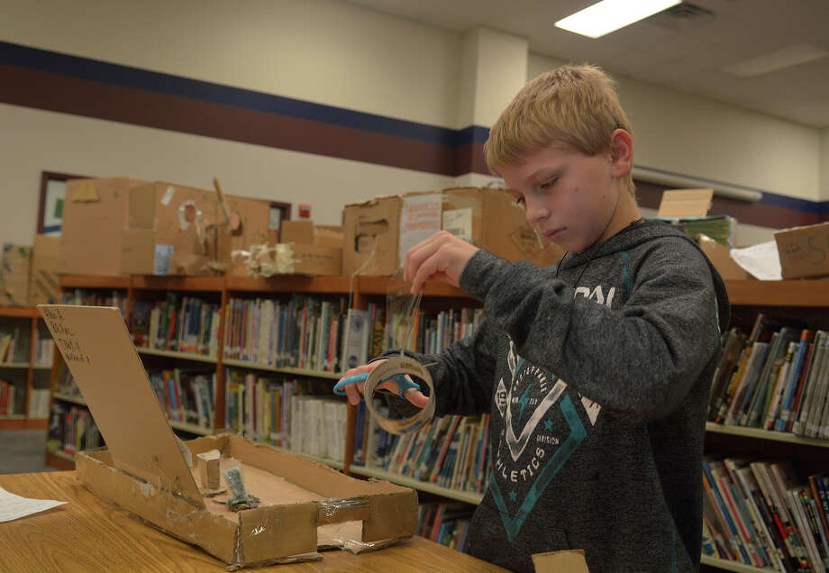 Bryce Chelette, 11, a 5th grader at Bear Branch Elementary, works on his team's cardboard air hockey game in the school library on Jan. 30, 2017. (Photo by Jerry Baker/Freelance) Photo: Jerry Baker, Freelance / Freelance