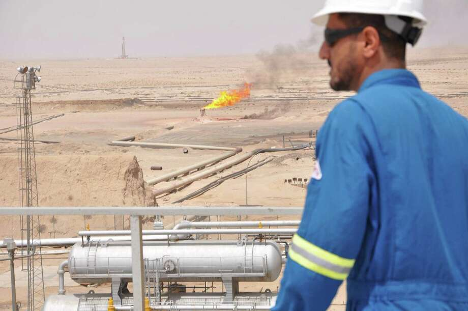 Natural gas burns off in an oil field in southern Iraq. In Iraq, some lawmakers already have called for a reciprocal ban against visa-holding U.S. travelers, including contractors Photo: Aaron C. Davis /Washington Post / The Washington Post