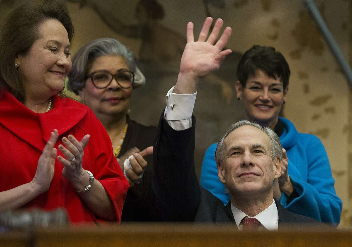 Texas Gov. Greg Abbott, right, prepares to give his State of the State address to a joint session of the House and Senate, Tuesday, Jan. 31, 2017, at the Texas Capitol in Austin, Texas. Cecilia Abbott, wife of Greg Abbott at left. (AP Photo/Stephen Spillman)