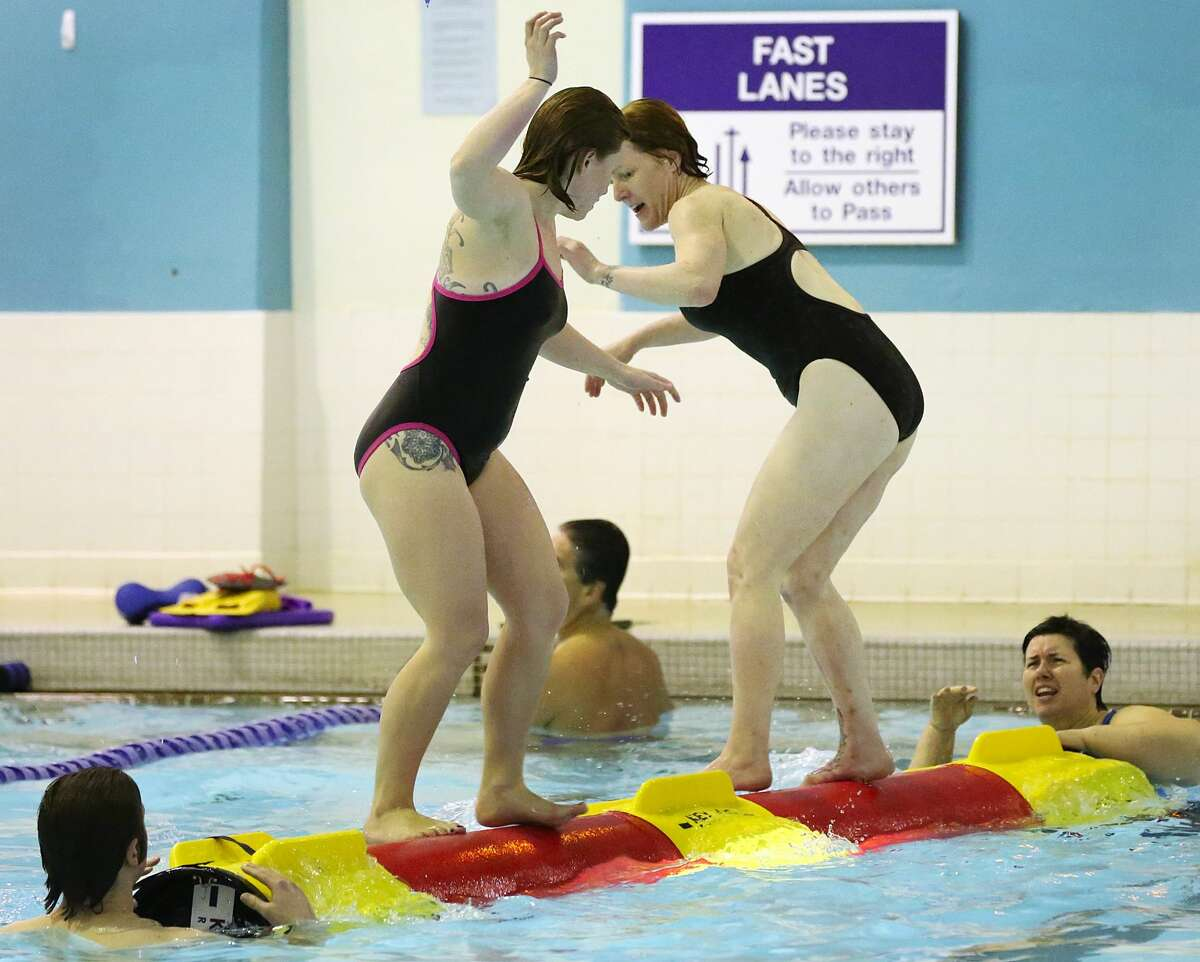 From left, Kirsten Fors battles Meagan Zielinski, as Carla Bigelow looks on, during a class in competitive log-rolling at the University of Washington on Sunday, Jan. 22, 2017, in Seattle, Wash. (Ken Lambert/Seattle Times/TNS)