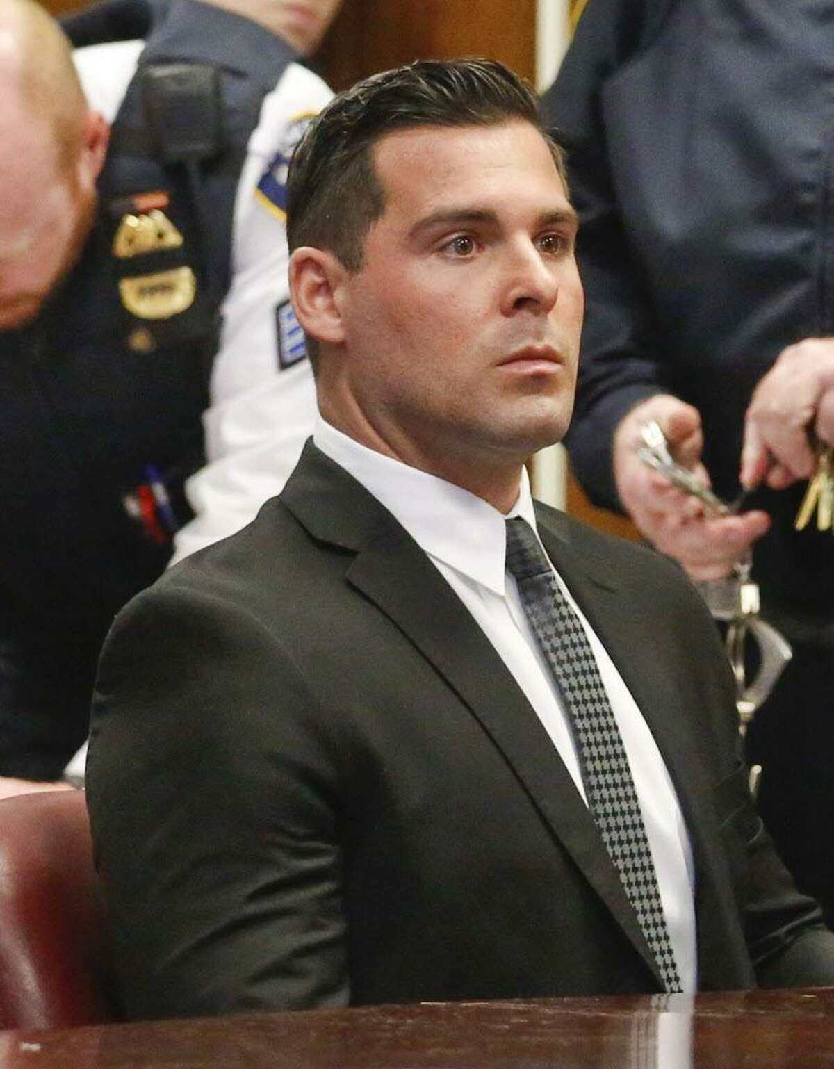 FILE - Lawrence Dilione, 28, of New Jersey, listens as his lawyer speaks during his hearing in criminal court, Tuesday Dec. 13, 2016, in New York.
