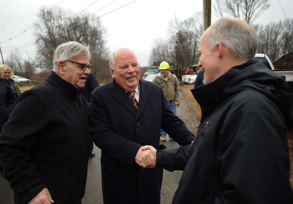Temple , center, greets building committee members Jim Westgate, right, and Barry Schiff, left, during the groundbreaking ceremony for the new Oxford Public Library on Great Oak Road in Oxford, Conn. on Wednesday, January 18, 2017. The project is scheduled to be completed in December.