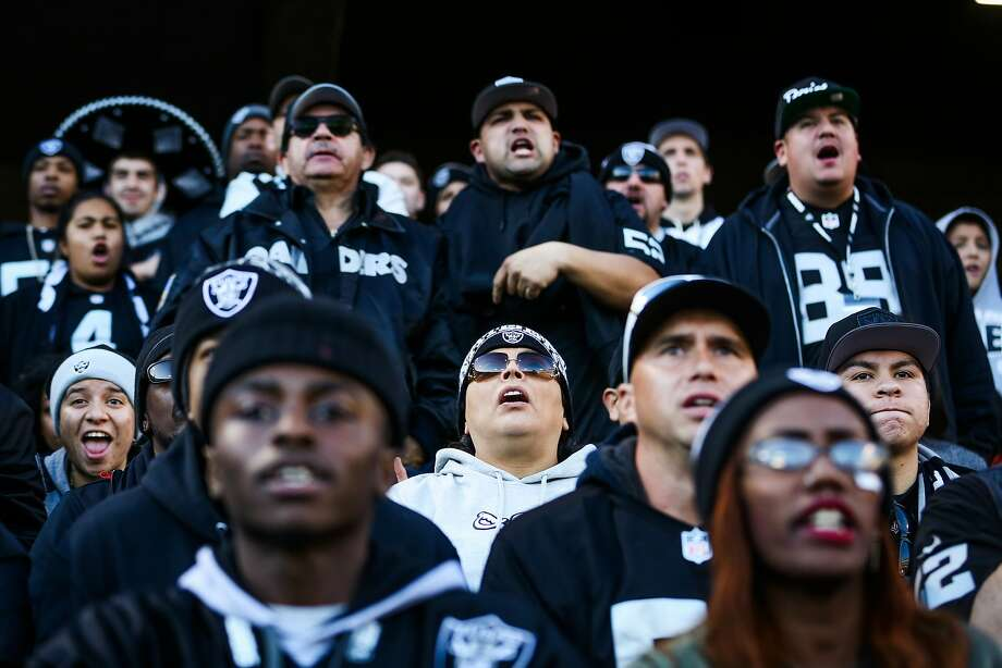 Raiders fans watch a game between the Oakland Raiders and the Indiana Colts in on Dec. 24, 2016. The Raiders' planned stadium in Las Vegas could get more expensive under the GOP tax plan, which would eliminate exemptions for stadium bonds. Photo: Gabrielle Lurie, The Chronicle