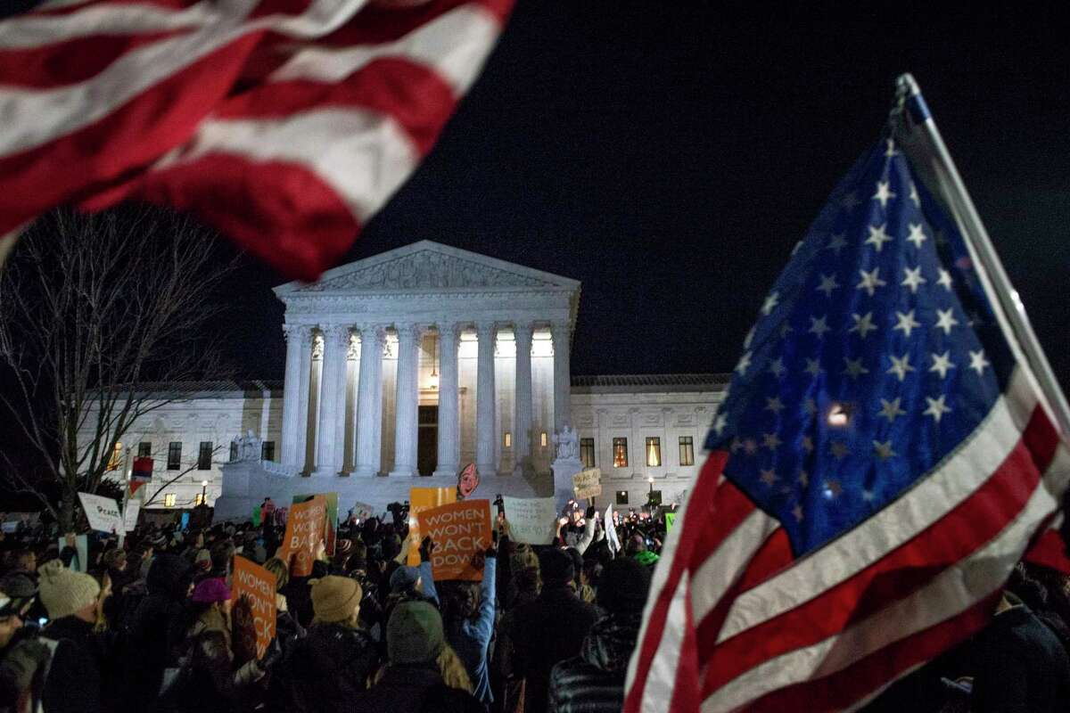 Protesters gather at a rally against President TrumpÂ?'s executive order banning entry to refugees and others from seven Muslim-majority countries, at the Supreme Court in Washington, Jan. 30, 2017. (Gabriella Demczuk/The New York Times)