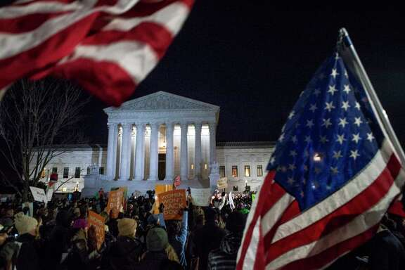 Protesters gather at a rally against President Trump's executive order banning entry to refugees and others from seven Muslim-majority countries, at the Supreme Court in Washington, Jan. 30, 2017. (Gabriella Demczuk/The New York Times)