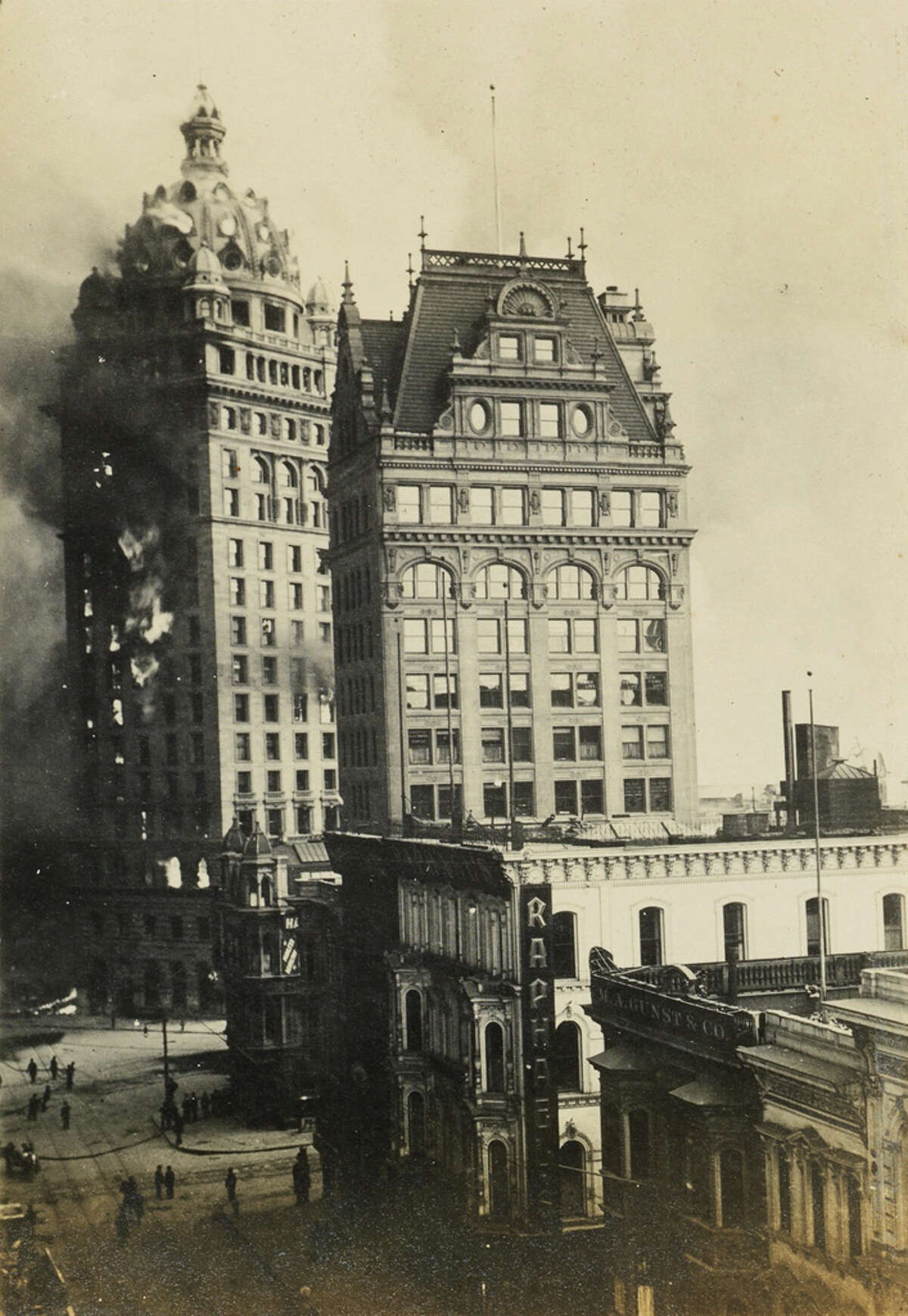 The Call Building engulfed in flames after the earthquake. The building was the tallest in the city when it was completed in 1898 and housed the San Francisco Call newspaper. After the fire, the Call moved its offices to The Montgomery.