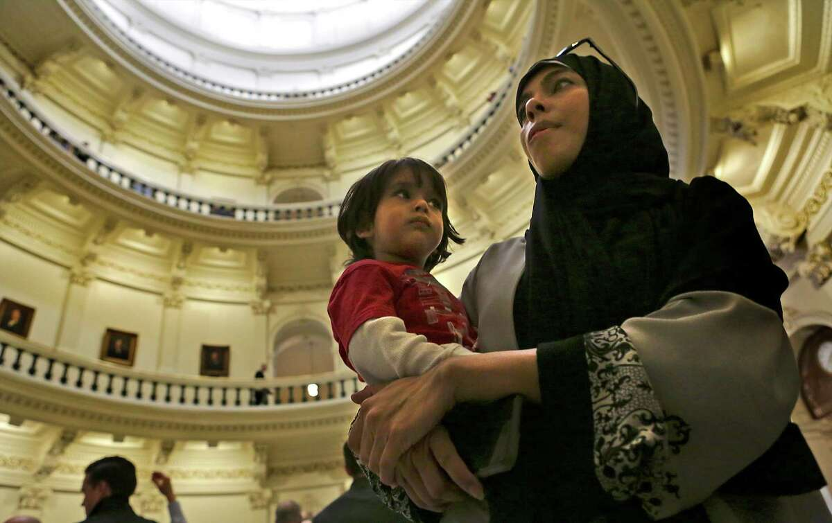 Saba Syed, of Houston, holds her two year old son Adam Shaikh, as they take in the Rotunda at the Texas State Capitol during the Texas Muslim Capitol Day, in Austin, Texas on Tuesday, Jan. 31, 2017.
