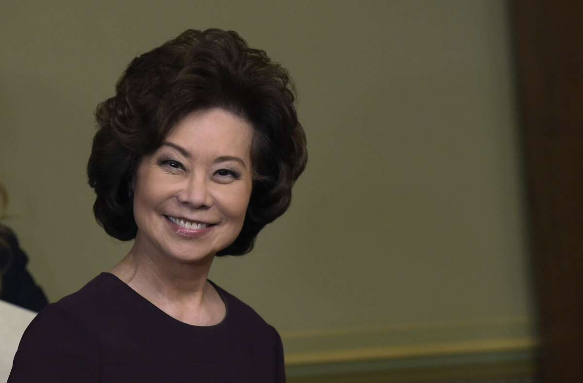 Transportation Secretary Elaine Chao arrives to be sworn in by Vice President Mike Pence in the Eisenhower executive Office Building in the White House complex in Washington, Tuesday, Jan. 31, 2017.