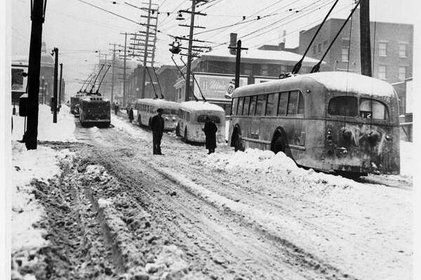 """""""Record low temperatures and heavy snow plagued the Seattle area during the winter of 1950. On Friday January 13, downtown Seattle received an average of ten inches of snow, with Sea-Tac airport reporting 21.4 inches, just shy of a 24-hour snowfall record. Although the snow let up on Saturday, the cold temperatures persisted for several more days. Seattle recorded nine days of temperatures below ten degrees between January 12 and February 4, 1950."""" -MOHAI. Photo courtesy MOHAI, Seattle P-I Collection, image number 1986.5.14568.1."""