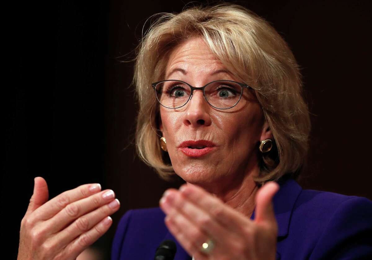 FILE - In this Jan. 17, 2017, file photo, Education Secretary-nominee Betsy DeVos testifies on Capitol Hill in Washington.