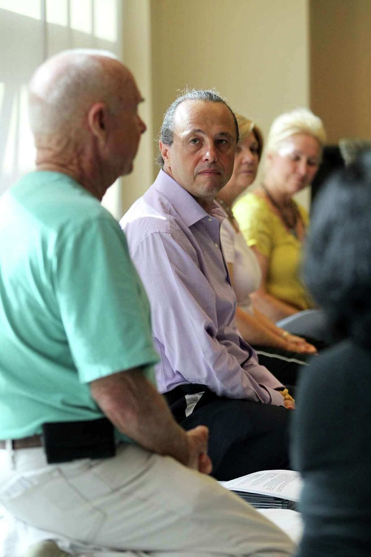 Alejandro Chaoul leads a discussion during a meditation class for cancer patients.
