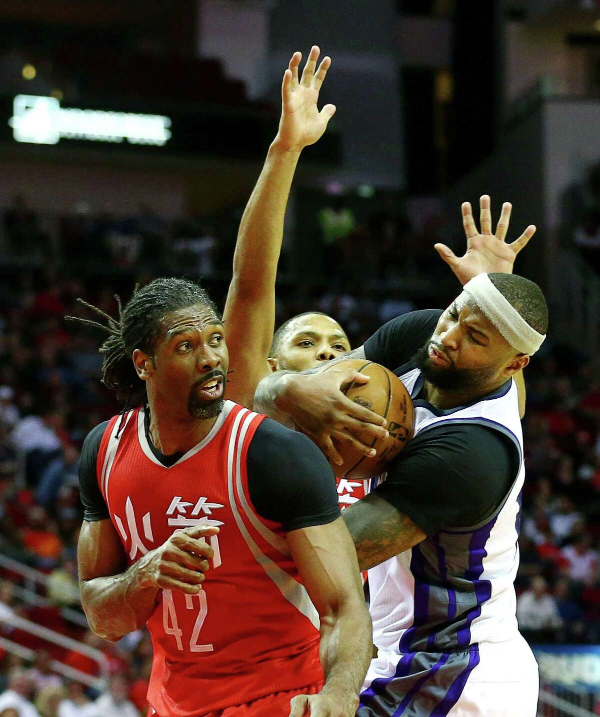 Sacramento Kings forward DeMarcus Cousins (15) runs into defense by Houston Rockets center Nene Hilario (42) and guard Eric Gordon (10) as he tries to drive to the basket during the second quarter of an NBA game at the Toyota Center, Tuesday, Jan. 31, 2017, in Houston.