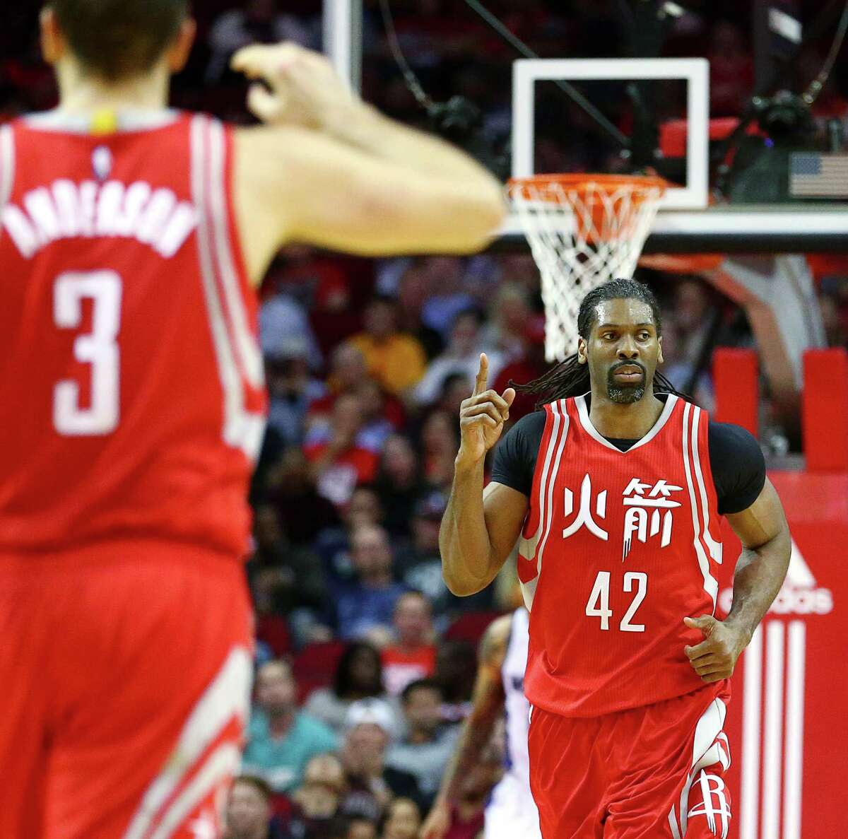 Houston Rockets center Nene Hilario (42) celebrates after scoring during the second quarter of an NBA game at the Toyota Center, Tuesday, Jan. 31, 2017, in Houston.