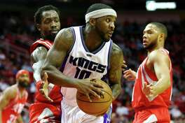Sacramento Kings guard Ty Lawson (10) looks to pass while under pressure from Houston Rockets guard Patrick Beverley (2) during the second quarter of an NBA game at the Toyota Center, Tuesday, Jan. 31, 2017, in Houston.