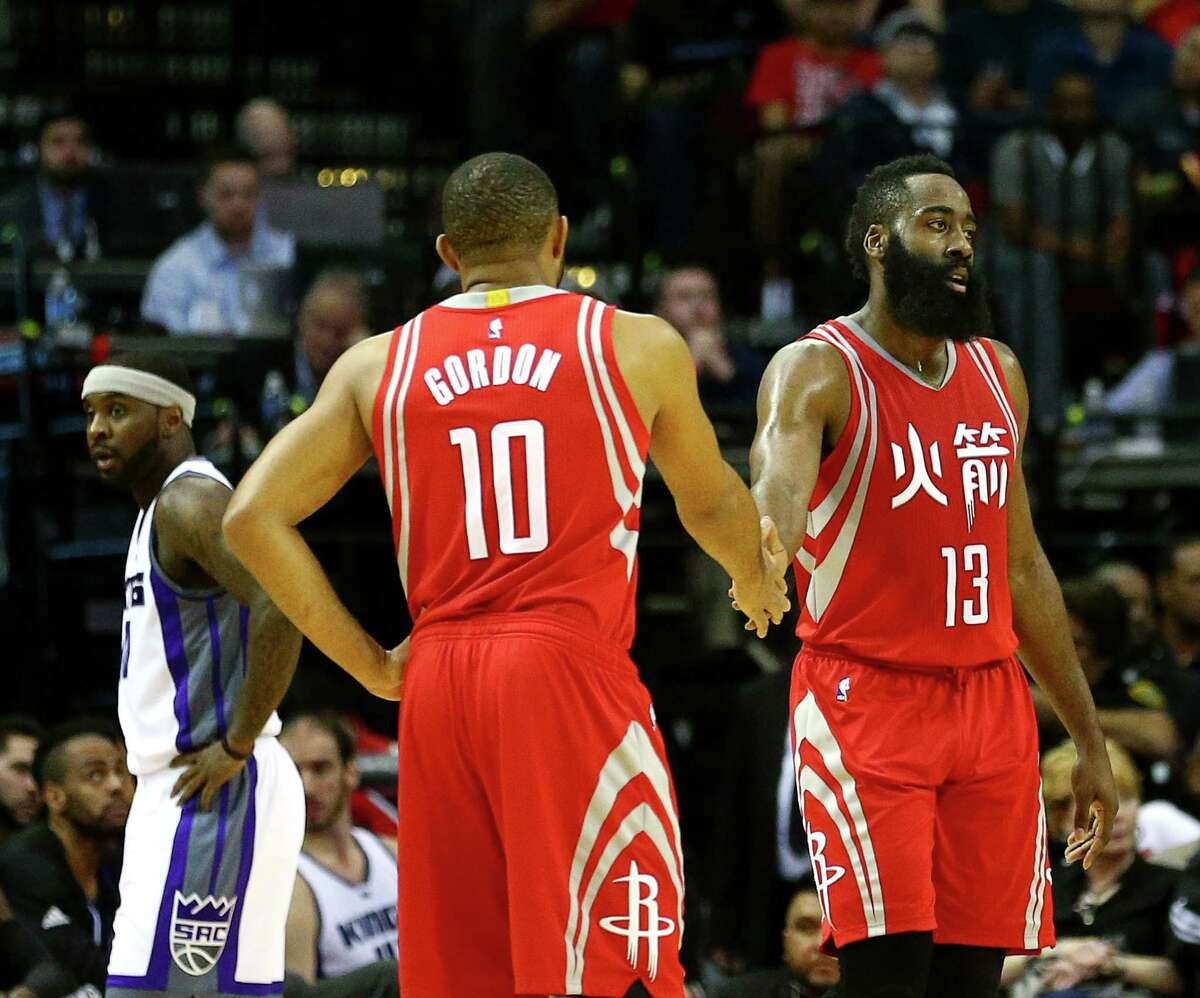 Houston Rockets guard James Harden (13) high-fives guard Eric Gordon (10) during the first quarter of an NBA game at the Toyota Center, Tuesday, Jan. 31, 2017, in Houston.