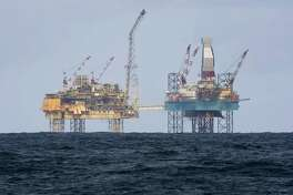 Shell is a shareholder in the Elgin rig, shown here operating 150 miles from Aberdeen in the North Sea in 2012. Shell is selling stakes in 10 North Sea fields.