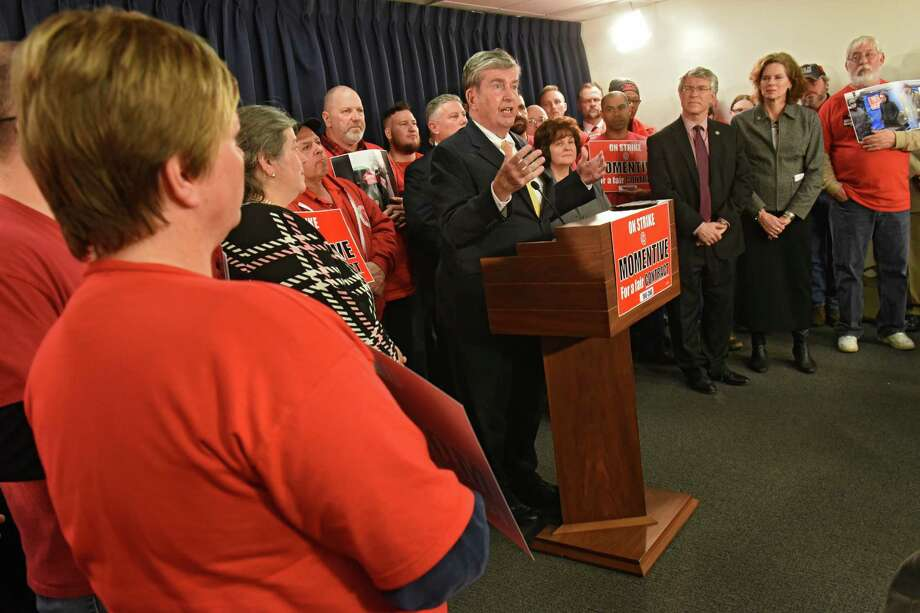 New York Senator Neil Breslin gives his support as workers on strike at the Momentive chemical plant in Waterford travel to Albany to alert lawmakers to the ways in which national hedge funds are destroying good jobs in Upstate New York at the Legislative Office Building on Tuesday, Jan. 31, 2017 in Albany, N.Y. (Lori Van Buren / Times Union) Photo: Lori Van Buren / 20039577A