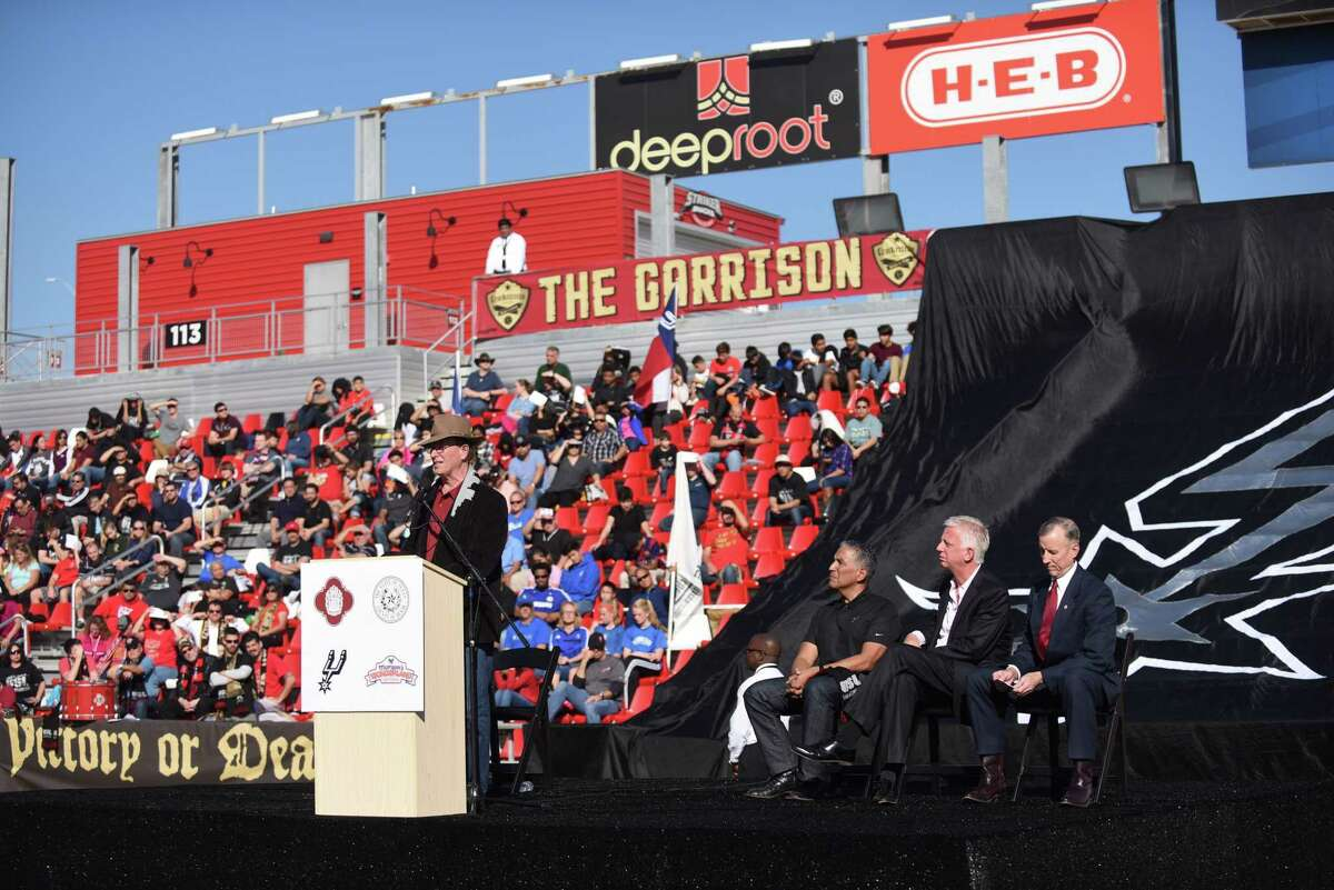 County Judge Nelson Wolff (left) speaks as Bobby Perez, Spurs Sports & Entertainment vice president and general counsel, San Antonio Scorpions owner Gordon Hartman and City Councilman Mike Gallagher sit by during a press conference to announce that San Antonio will acquire an expansion team in the USL soccer league this coming spring at Toyota field on Tuesday, Dec. 22, 2015.