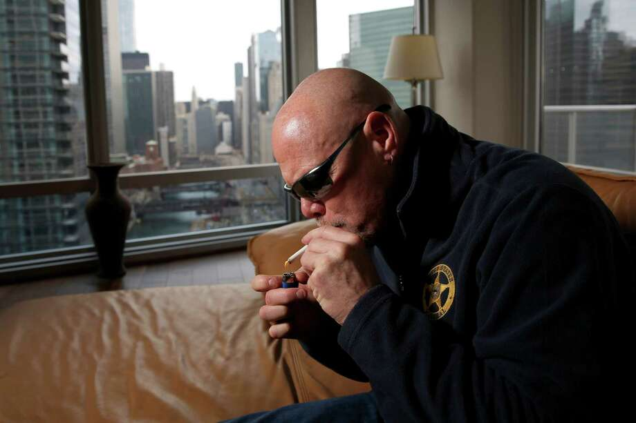 Former Bears quarterback Jim McMahon, who has struggled with early onset dementia, lights up some medicinal marijuana last year in Chicago. Photo: Jose M. Osorio, MBO / Chicago Tribune