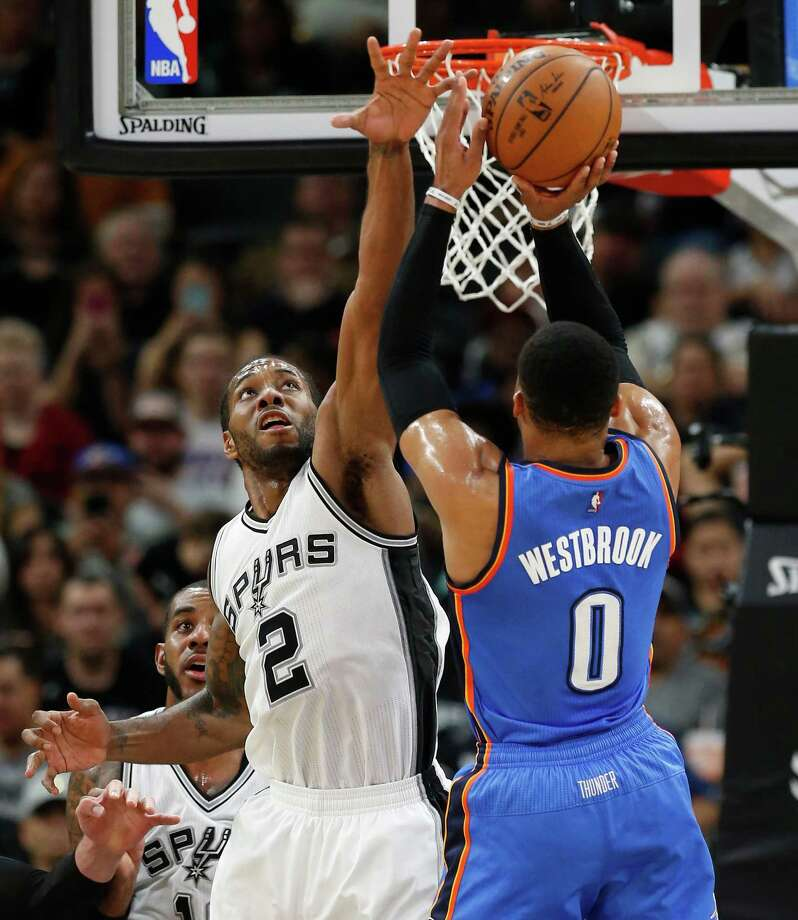 Spurs' Kawhi Leonard (02) defends against Oklahoma City Thunders' Russell Westbrook (00) during their game at the AT&T Center on Tuesday, Jan. 31, 2017. Spurs defeated the Thunder, 108-94. Photo: Kin Man Hui, San Antonio Express-News / ©2017 San Antonio Express-News