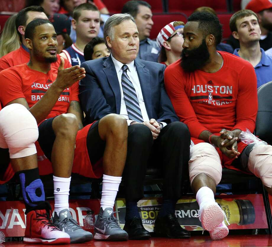 Rockets coach Mike D'Antoni, left, has a rare chance for a casual fourth-quarter visit with James Harden. Photo: Jon Shapley, Staff / © 2017  Houston Chronicle