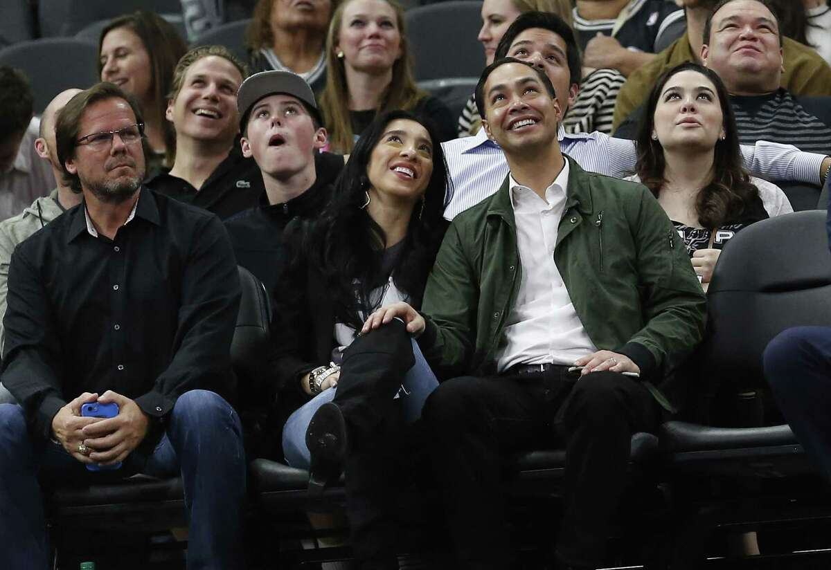 Julian Castro (right), former Secretary of Housing and Urban Development and former city mayor, along with his wife Erica attend the Spurs game against the Oklahoma City Thunder at the AT&T Center on Tuesday, Jan. 31, 2017. Last week Castro criticized the White House plan to crack down on recreational pot, calling it'a mistake.'