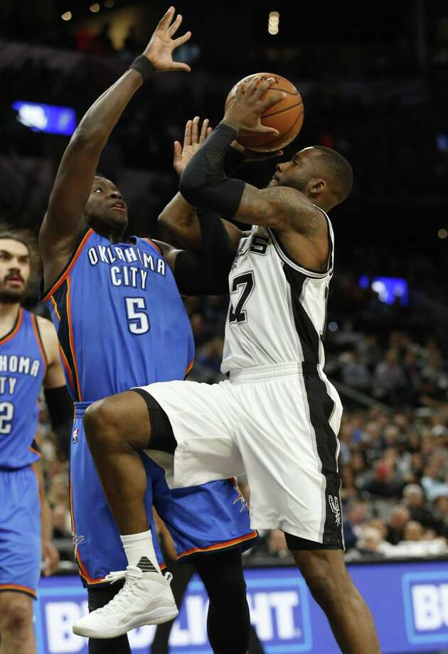 Spurs' Jonathon Simmons (17) goes for a shot against Oklahoma City Thunders' Victor Oladipo (05) during their game at the AT&T Center on Tuesday, Jan. 31, 2017. (Kin Man Hui/San Antonio Express-News) Photo: Kin Man Hui, Staff / San Antonio Express-News / ©2017 San Antonio Express-News