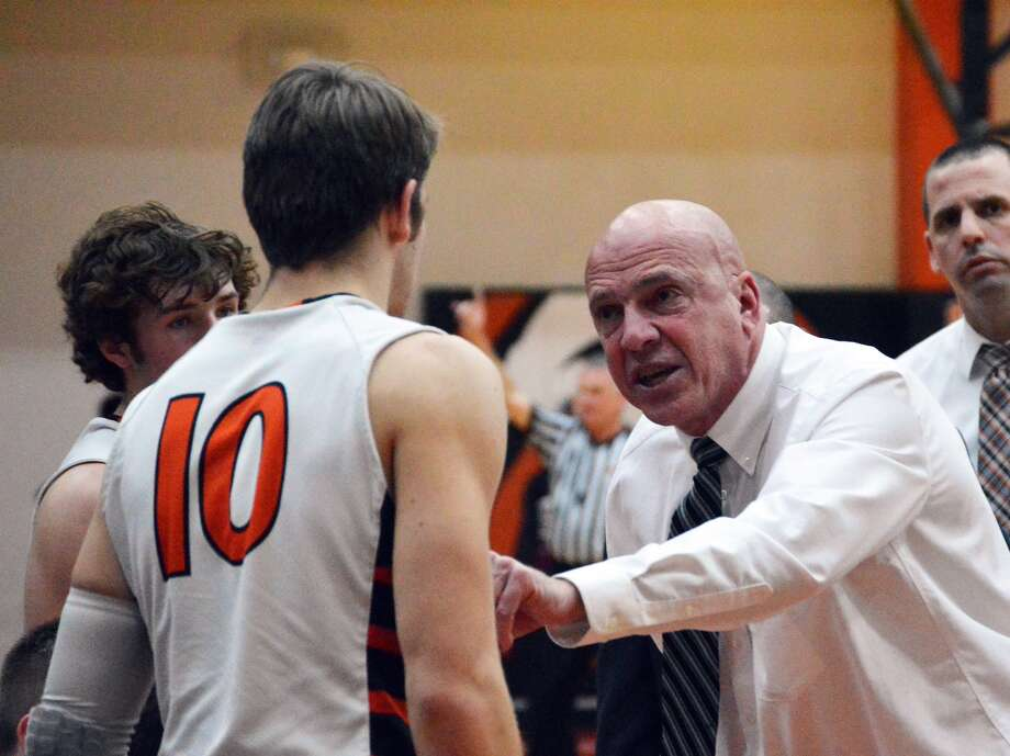 Edwardsville coach Mike Waldo talks to senior Nathan Kolesa during a timeout in a Jan. 27 game against Belleville West at Lucco-Jackson Gym.