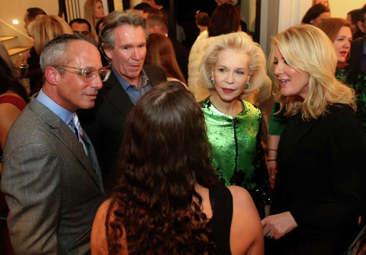 Food Network personality Sandra Lee (right) introduces Lynn Wyatt to Lee's daughter during a party celebrating BBVA's