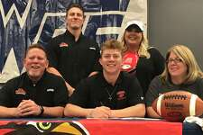 West Orange-Stark quarterback Jack Dallas is surrounded by family on National Signing Day.