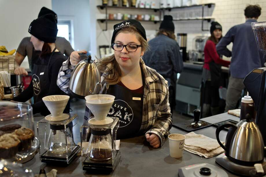Live Oak Coffeehouse barista Kaitlyn Mercy makes a pour over coffee during the opening day of the coffeehouse located at 711 Ashman. Live Oak is open everyday from 6 a.m. to 9 p.m. Photo: Brittney Lohmiller/Midland Daily News/Brittney Lohmiller