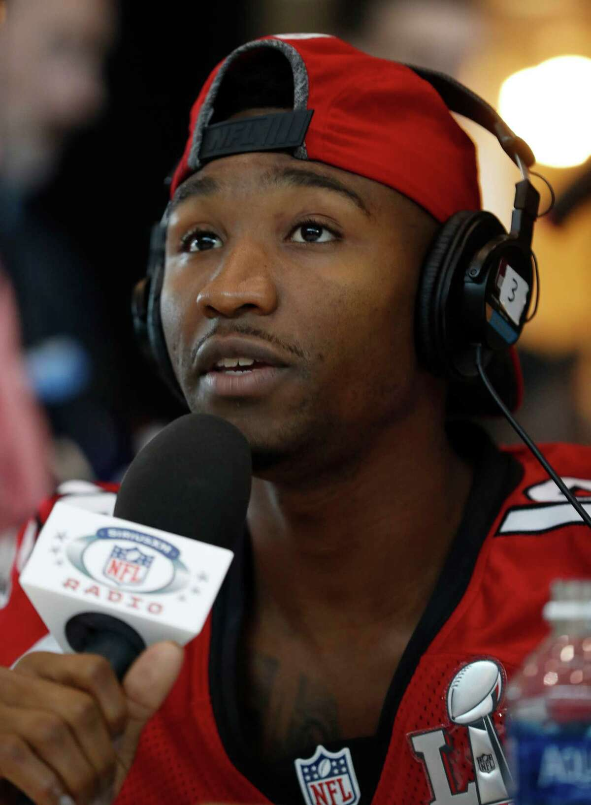 Atlanta Falcons wide receiver Taylor Gabriel (18) talks to a radio show during the Falcons media session at the Memorial City Mall Ice Arena, Wednesday, February 1, 2017.