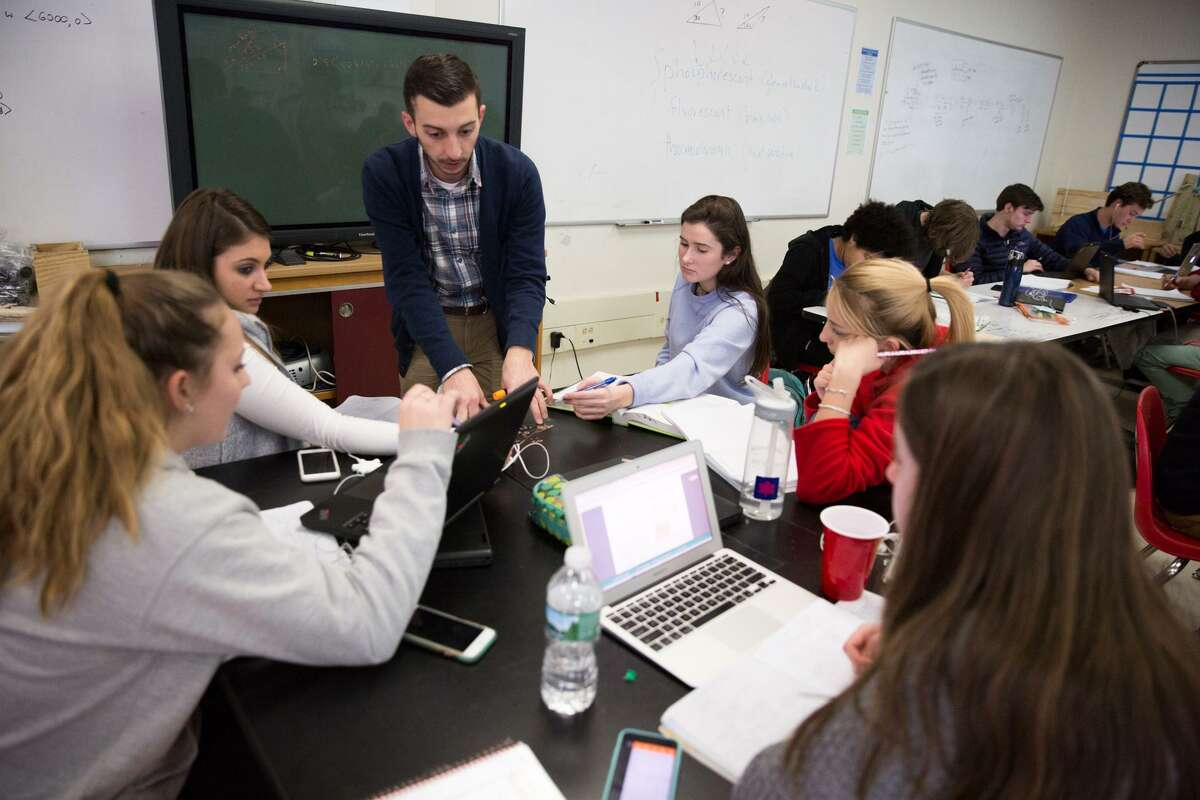 Brian Walach assists his students with a math problem in the Greenwich High School Innovation Lab on Thursday, December 15, 2016. The Innovation Lab has received more than $250,000 in funding from the Greenwich Alliance for Education over the past three years.