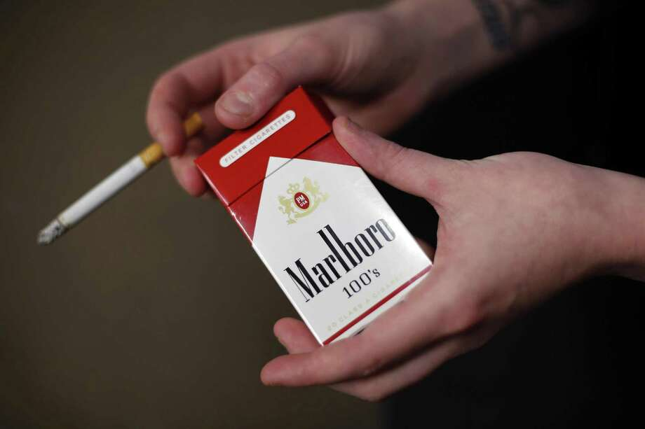 Altria's cigarette sales fell 1.9 percent to $5.45 billion as shipment volume of its cornerstone brand, Marlboro, declined 4.8 percent. Photo: Associated Press /File Phot / Copyright 2016 The Associated Press. All rights reserved. This material may not be published, broadcast, rewritten or redistribu
