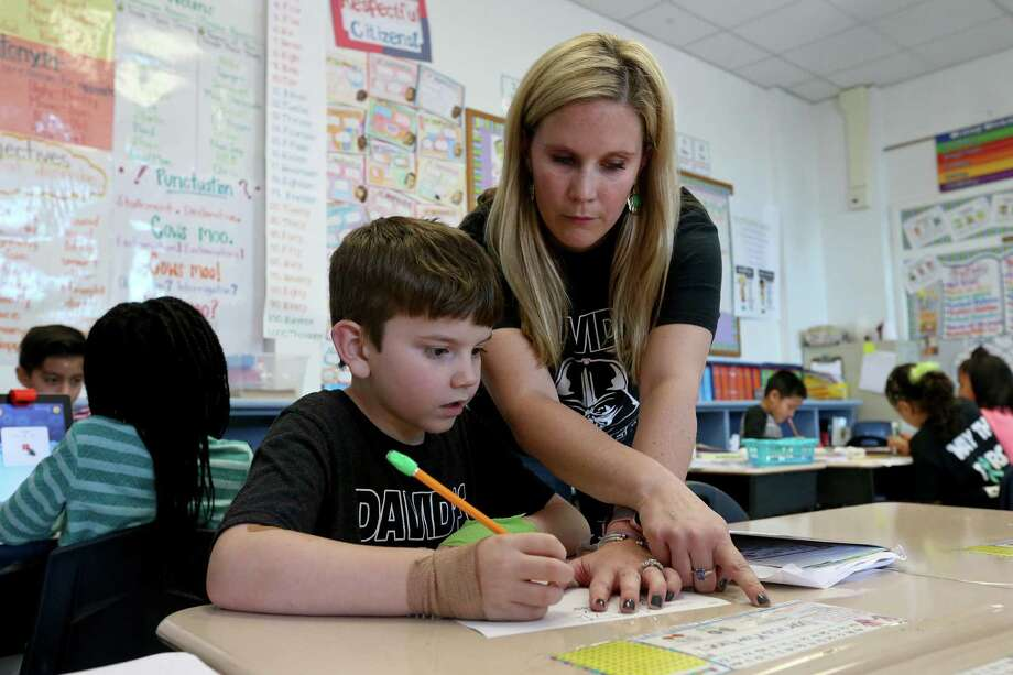 Fort Sam Houston Elementary School second-grade teacher Mindy Layne works with student David Chanek Thursday Jan. 19, 2017 at the school. Chanek suffers from hemophilia, and Hemophagocytic Lymphohistiocytosis (HLH), a life-threatening immune condition. Photo: Edward A. Ornelas, Staff / San Antonio Express-News / © 2017 San Antonio Express-News