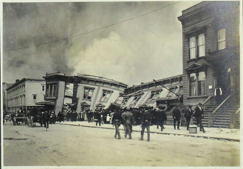 Collapsed houses seen after the earthquake. Photo: Courtesy Swann Auction Galleries