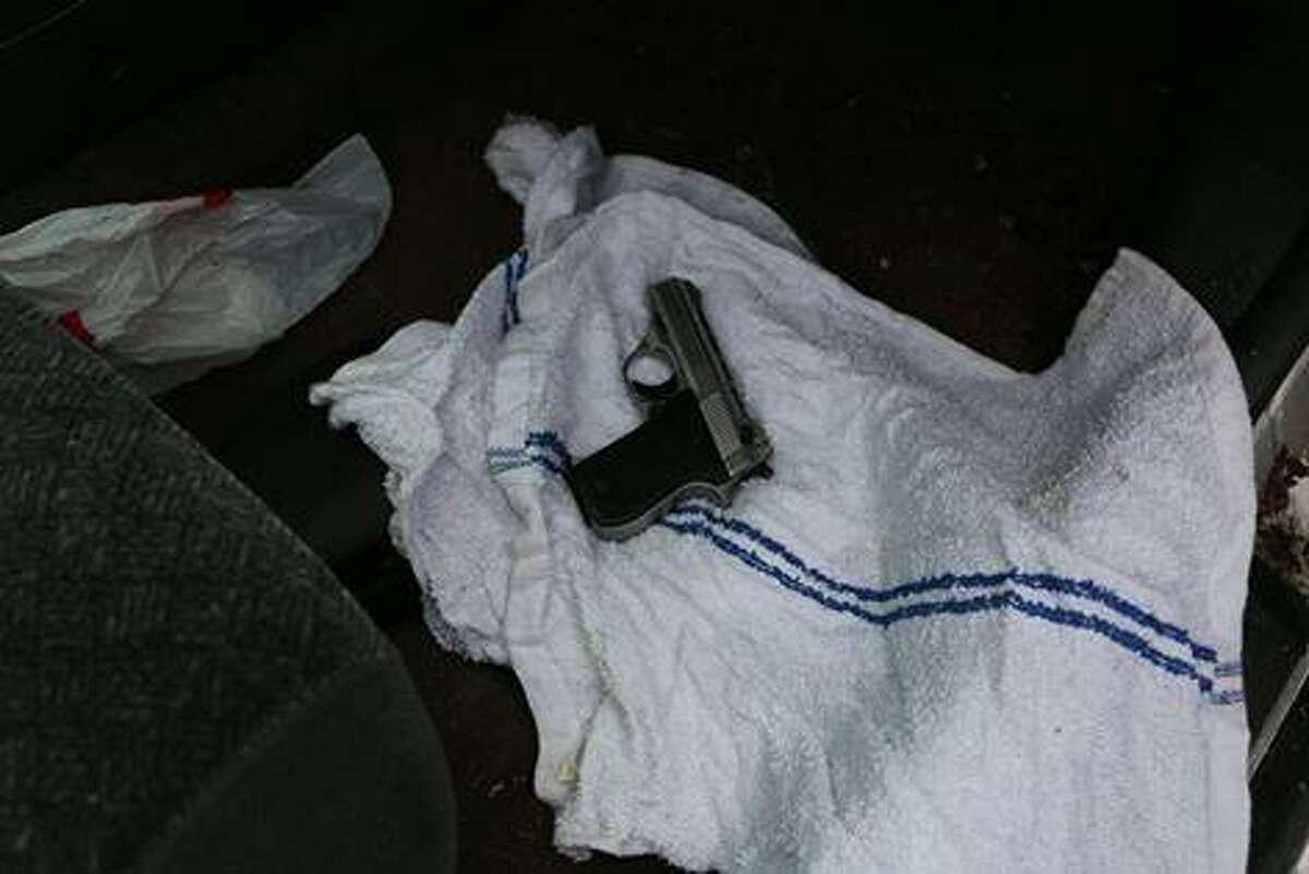 Police seized marijuana, a 12-gauge shotgun and a .380 caliber handgun following the raid of a Westport Avenue home Tuesday.