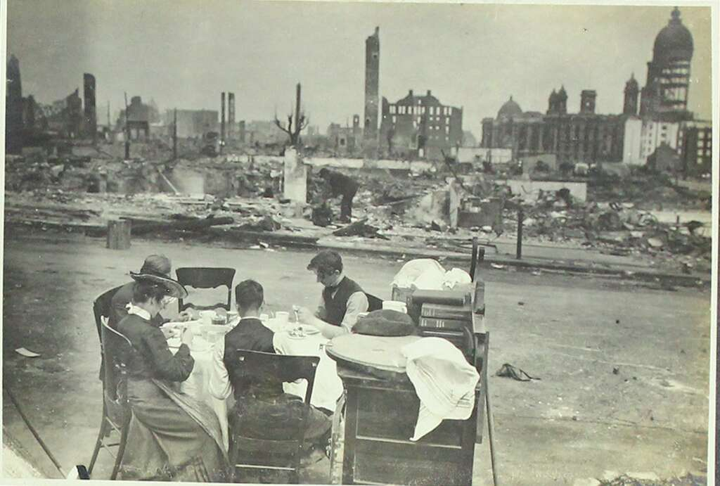 Survivors of the 1906 earthquake and fire sit amongst the rubble with their remaining belongings.