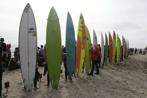 Surfers line up to be announced for the opening ceremony of the Titans of Maverick on Saturday, Oct. 24, 2015 in Half Moon Bay, Calif.