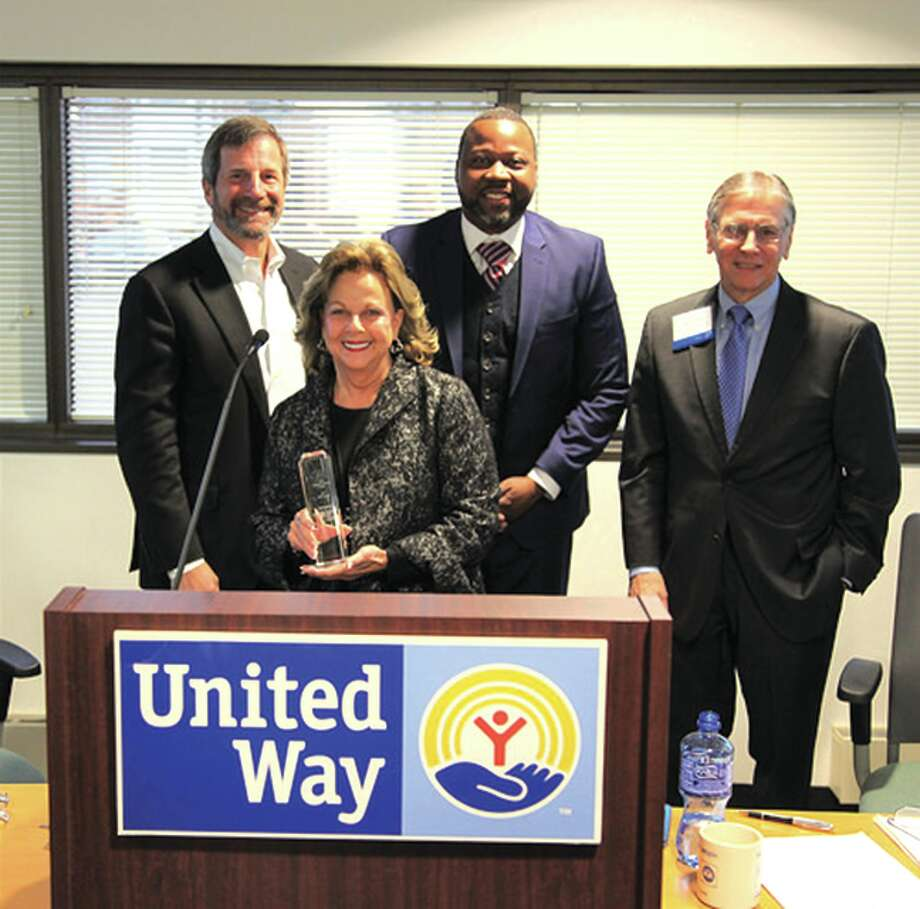 Dr. Beatty receives the award with (from left to right): United Way board chair and CEO of HBM Holdings, Mike DeCola; Orv Kimbrough, president and CEO of United Way of Greater St. Louis; former United Way president and CEO, Gary Dollar. Photo: For The Intelligencer