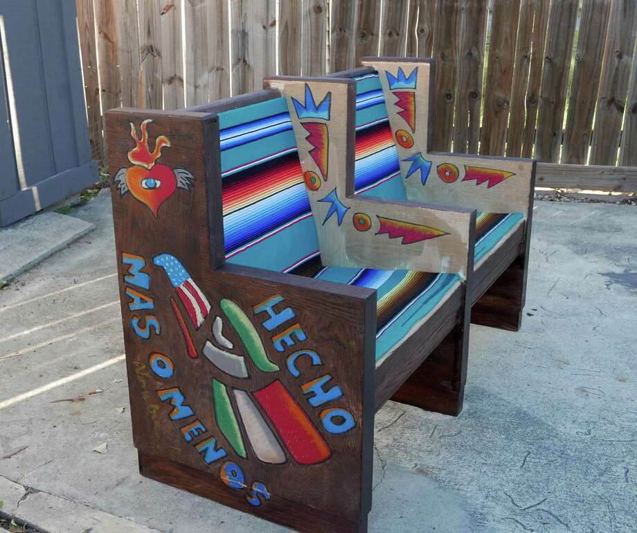 """Oscar Felan used oil pastels to create his designs on old church pews for the Westside Development Corp.'s """"Westside Pews"""" project. Photo: Billy Calzada /San Antonio Express-News / San Antonio Express-News"""