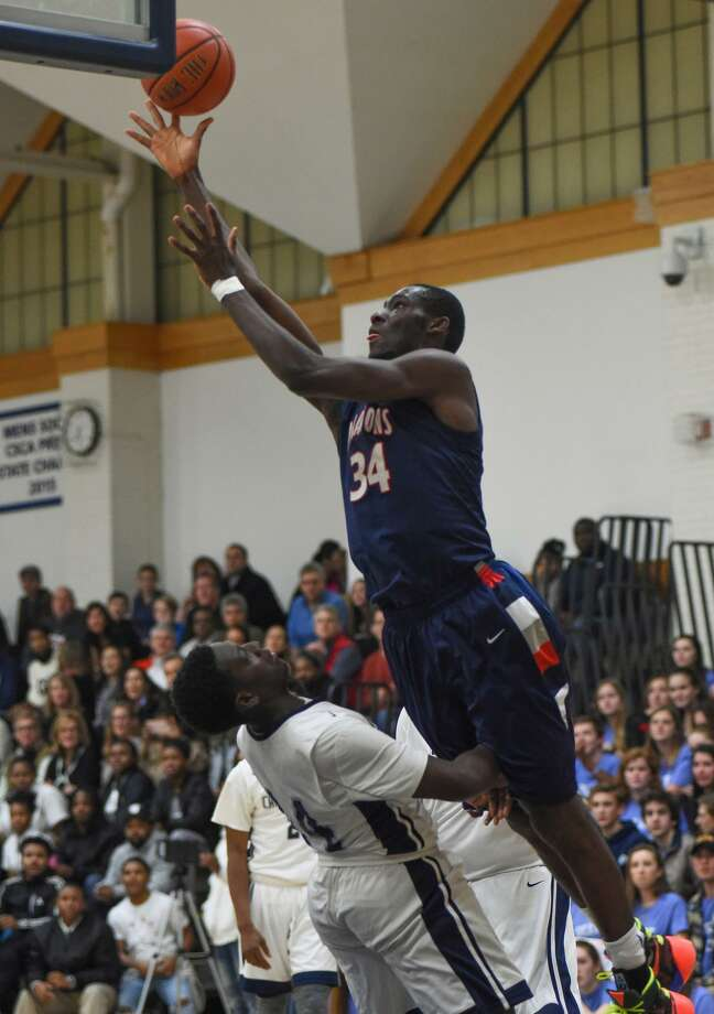 Greens Farms Academy's Sunday Okeke of Darien soars over an opponent from Capital Harbor Prep in the GFA's 87-74 victory at home Friday, Jan. 27. Okeke had 11 points on the night. Photo: Contributed Photo / Darien News contributed