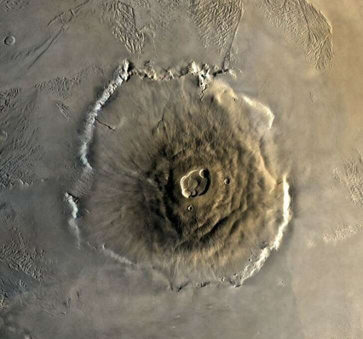 Olympus Mons is a shield volcano on Mars that is about the size of Arizona.
