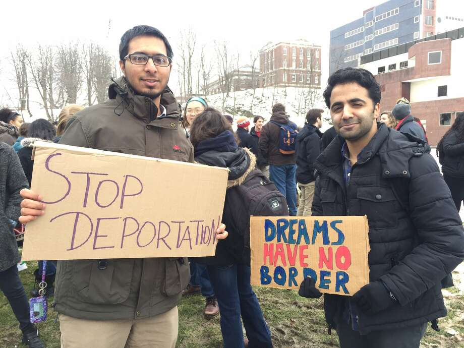 Talha Anwar and Adeel Minhas are not directly affected by the  travel ban but say, as Muslims, they feel targeted anyway. (Bethany Bump/Times Union)