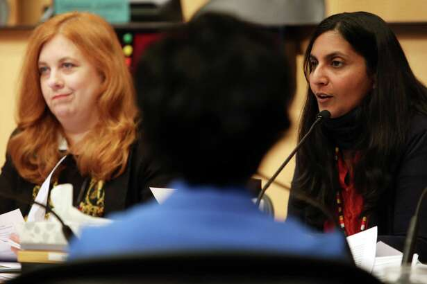 Councilmembers Kshama Sawant, right, and Lisa Herbold, speak during a City Council Finance Committee meeting  on a bill that would divest about $3 billion in city money from Wells Fargo Bank because of the bank's involvement in the Dakota Access Pipeline, Wednesday morning, Feb. 1, 2017.