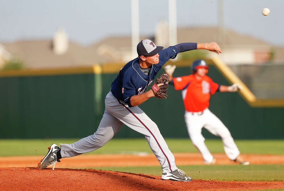 Tompkins pitcher Carson Rollins fires off a pitch to a waiting Seven Lakes batter as the two teams faced off in district play at Seven Lakes High School in Katy on April 8, 2016. Photo: Diana L. Porter, Freelance / © Diana L. Porter